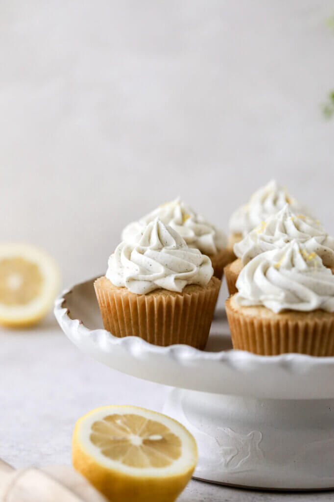 A cake stand with lemon cupcakes and dairy-free buttercream